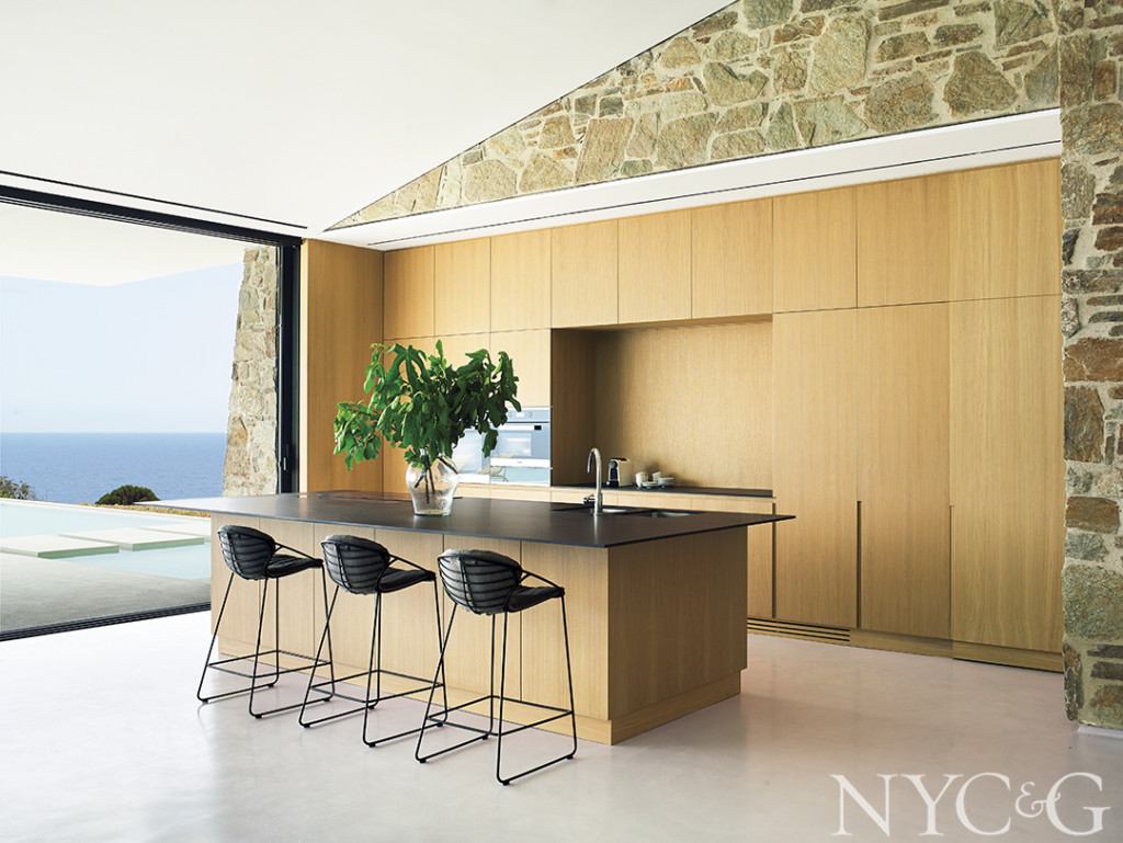 contemporary wood paneled kitchen with island and bar stools