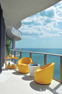 terrace overlooking ocean with yellow furniture