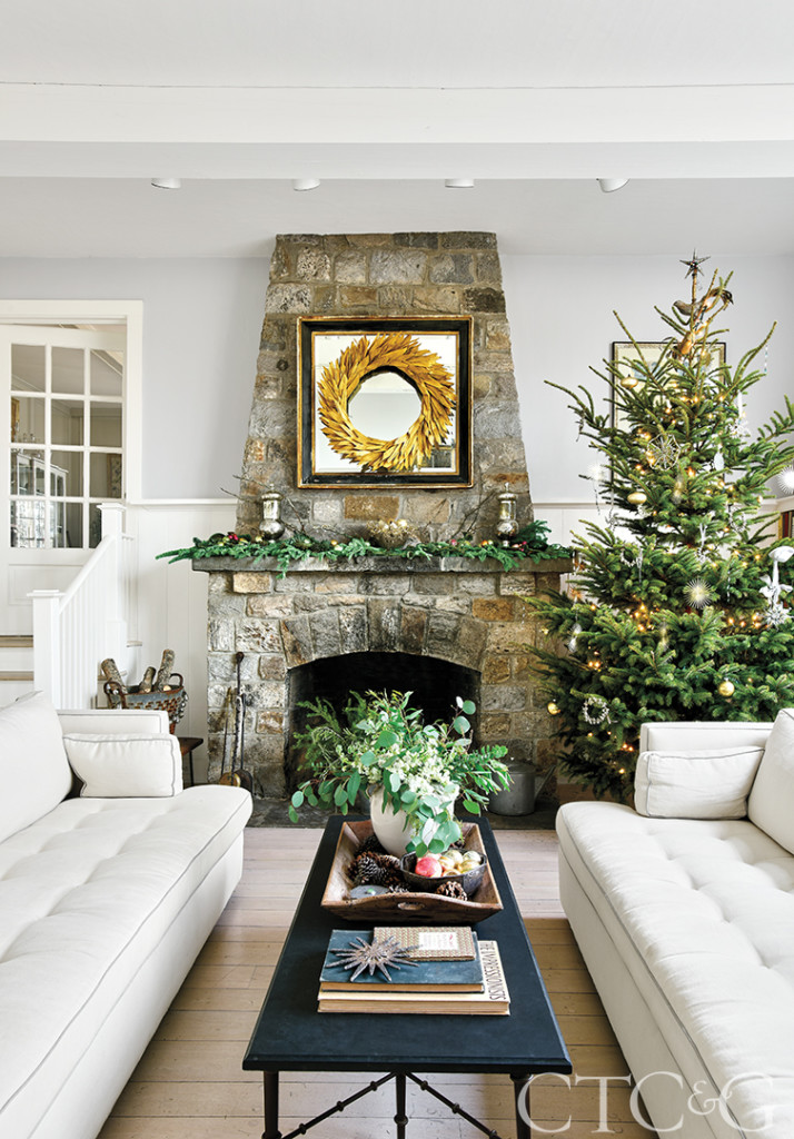 Holiday family room with fireplace and Christmas tree
