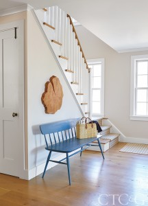 white hallway with blue bench