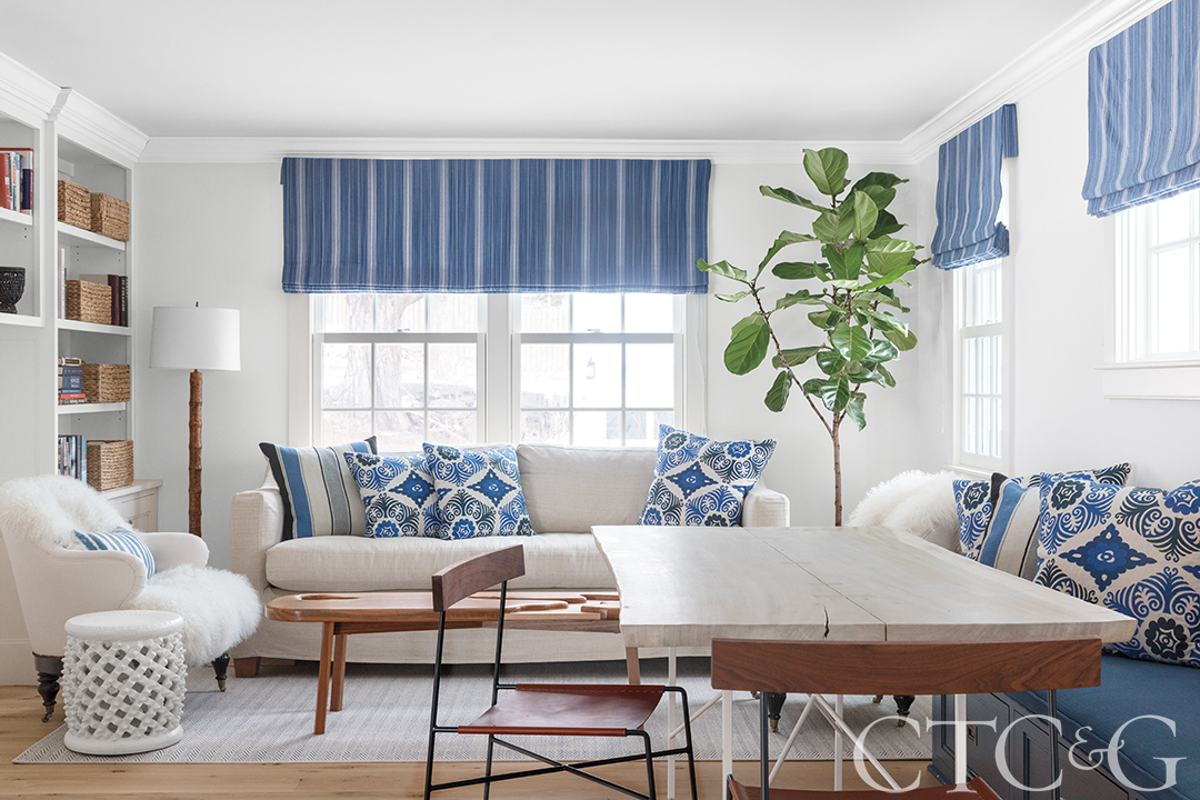 Family living room with couches, dining table and blue accents