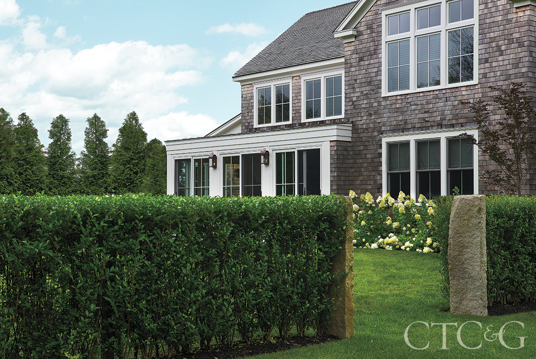 Martha's Vineyard New Construction's Garden With Hedges And Granite Pillars