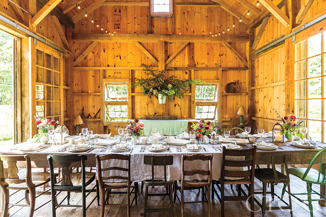 Dirt Road Farm Barn Supper Table Setting With Mis-Match Chairs