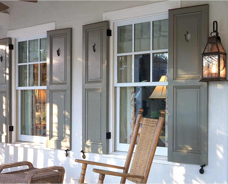 Gray Panel Shutters On Porch