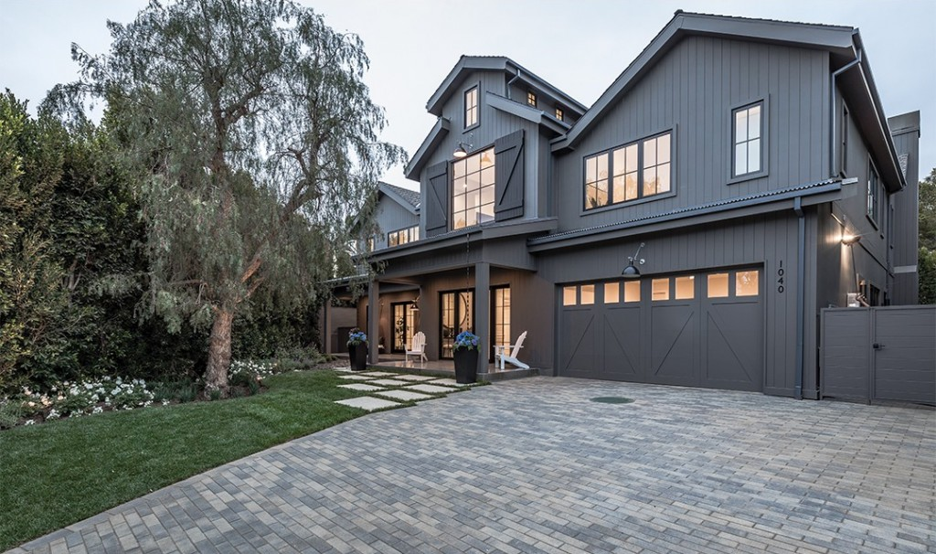 Black Home Exterior With Stone Driveway