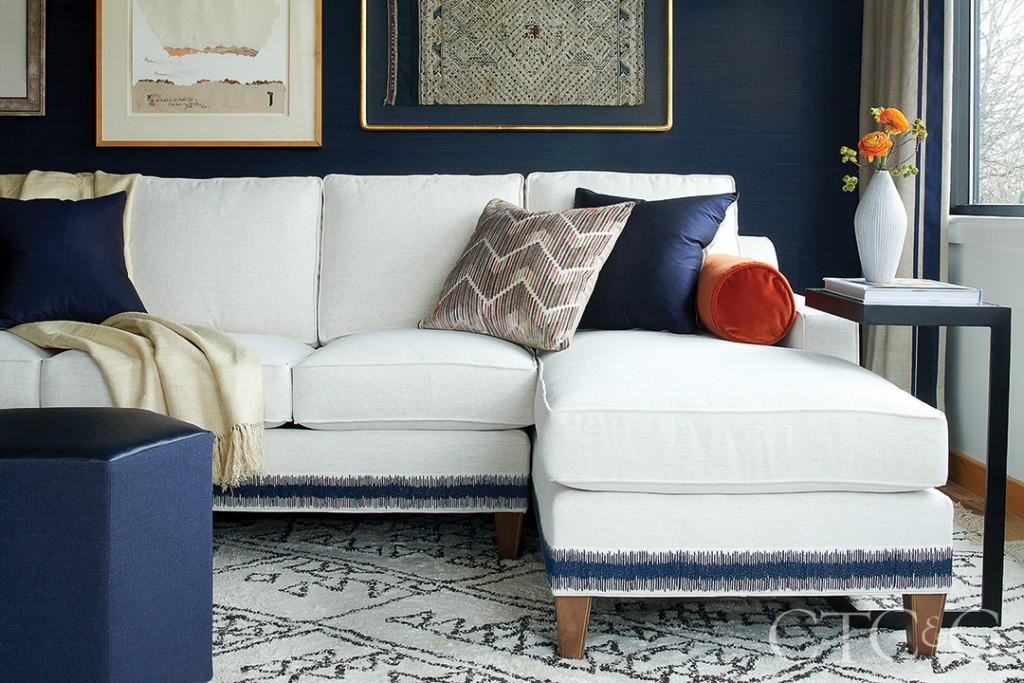 White Sectional With Blue Pillows