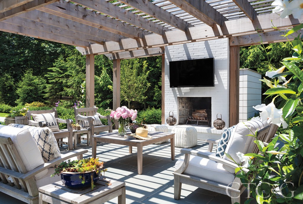 outdoor living area chairs and table and fireplace