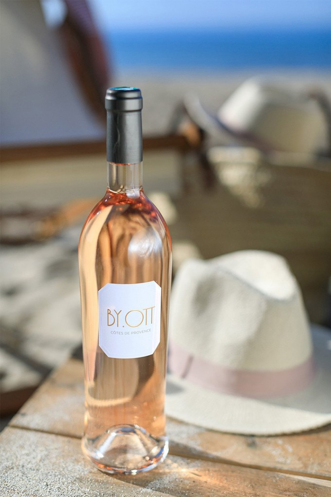 Rose wine bottle on table at the beach