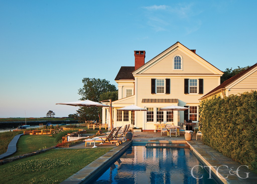 White Colonial Home With Inground Pool