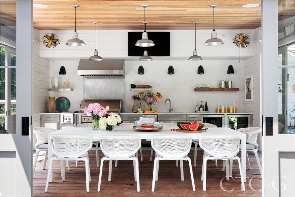indoor outdoor kitchen and dining room
