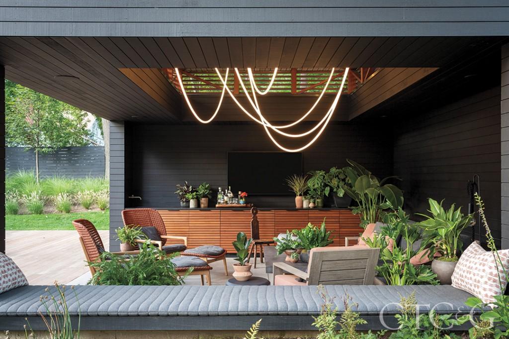 Modern black poolhouse living area