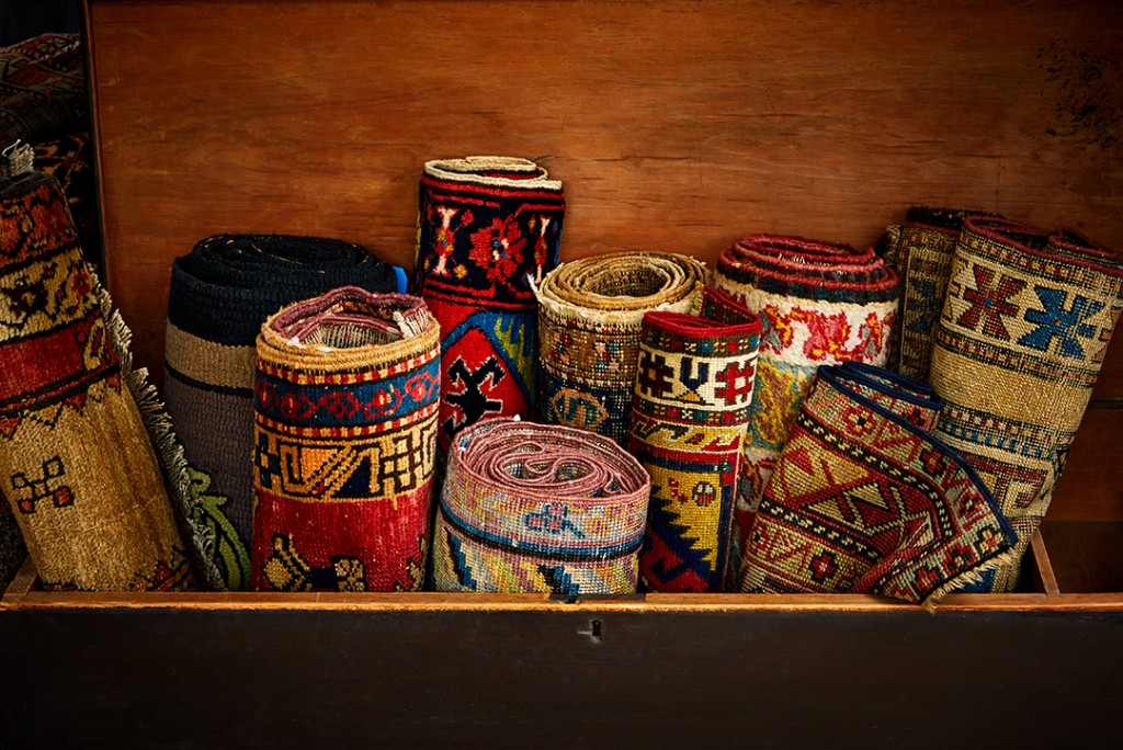 Group Of Rolled Up Antique Rugs