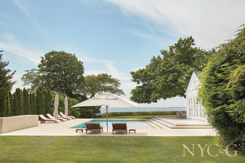 teak chaises and umbrellas; pool terrace