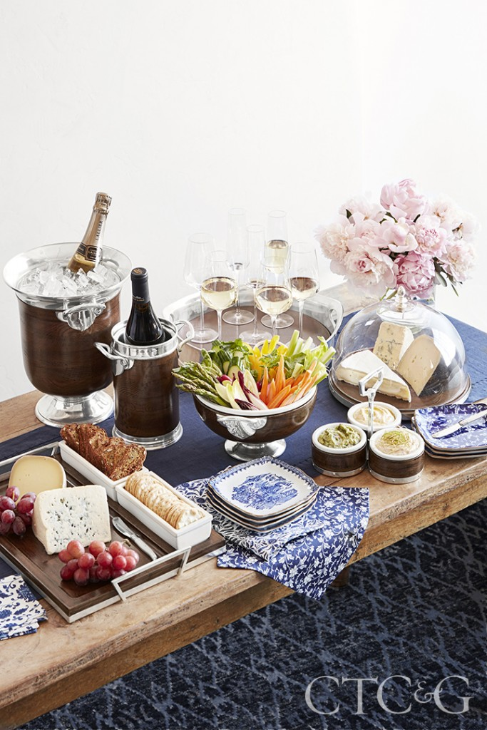 Buffet Table With Food And Champagne And Flowers