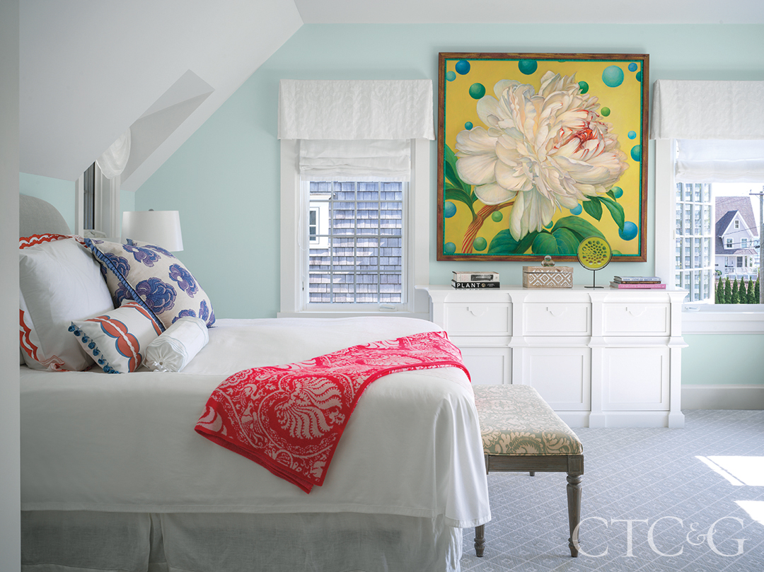 floral painting, bed, and Roman shades in primary bedroom