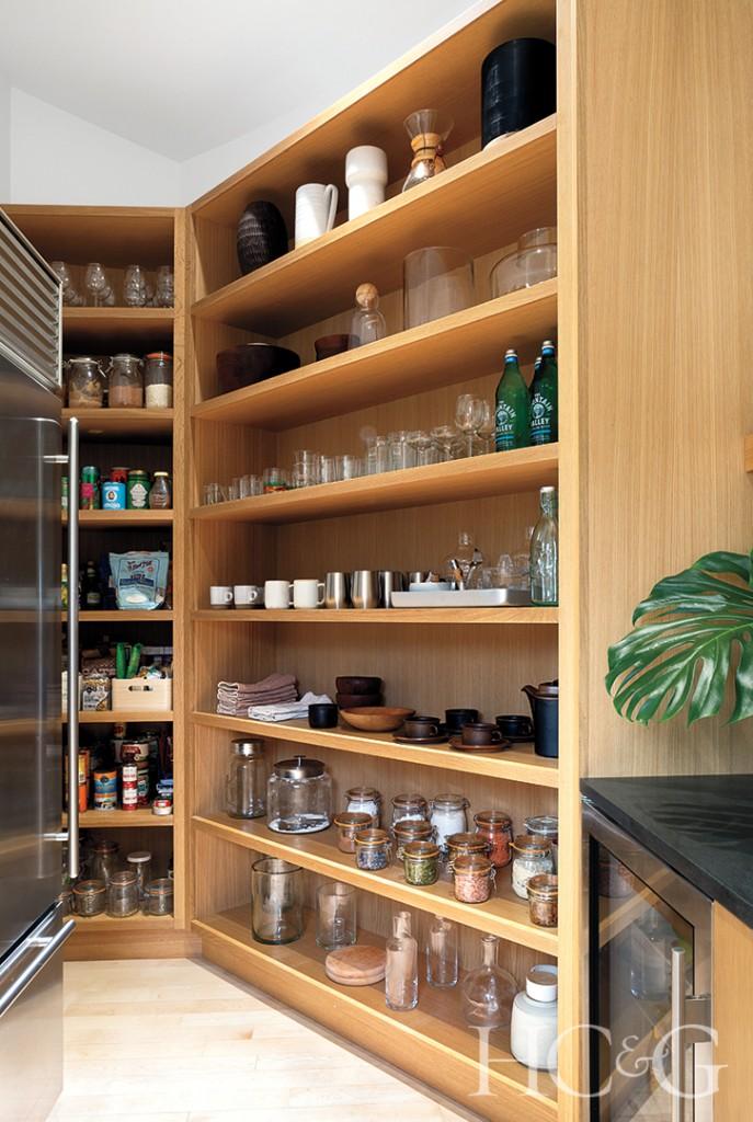 rift-oak pantry shelves and black kitchen counters