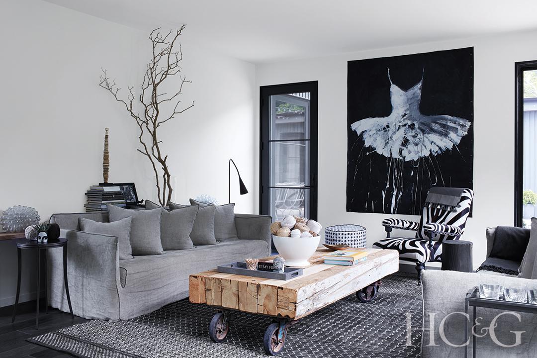 Italian linen sofa and custom cocktail table; zebra-print armchair in living room
