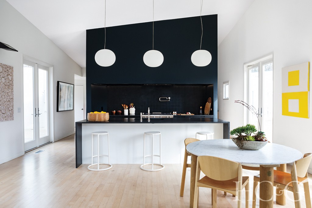 oak breakfast table and chairs in open kitchen; wall art and pantry
