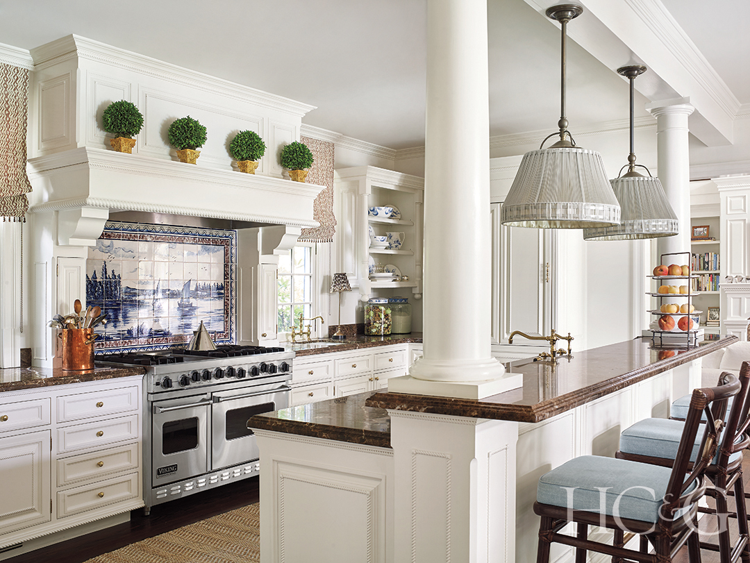 open kitchen with granite countertops and cushioned barstools