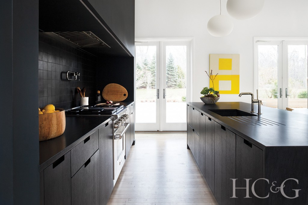 cabinetry and soapstone counters; stove, hood, sink, and pot filler