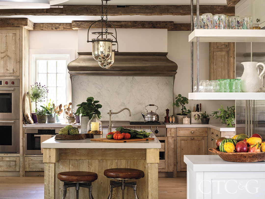 wood floors and cabinetry in kitchen; tile backsplash and island