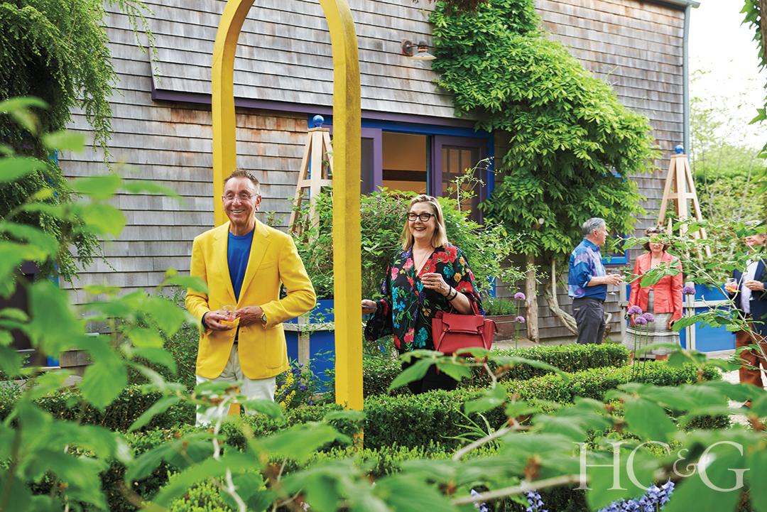 Art Dealer Robert Lococo And Shelly Fremont Walk Through The Garden