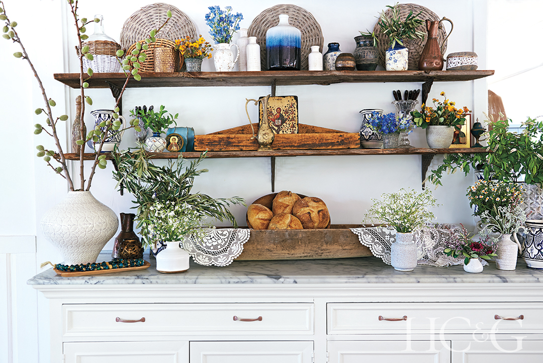 olive and almond branches and chamomile decorate a credenza