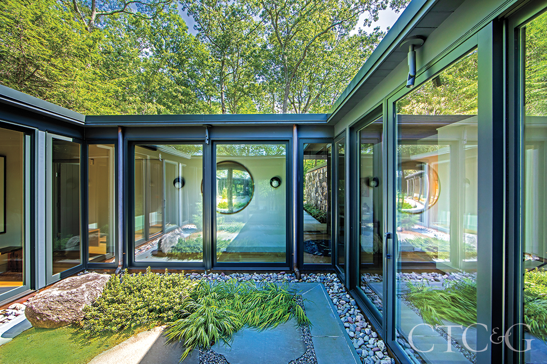 Mid Century Modern Home Courtyard With All Glass Windows