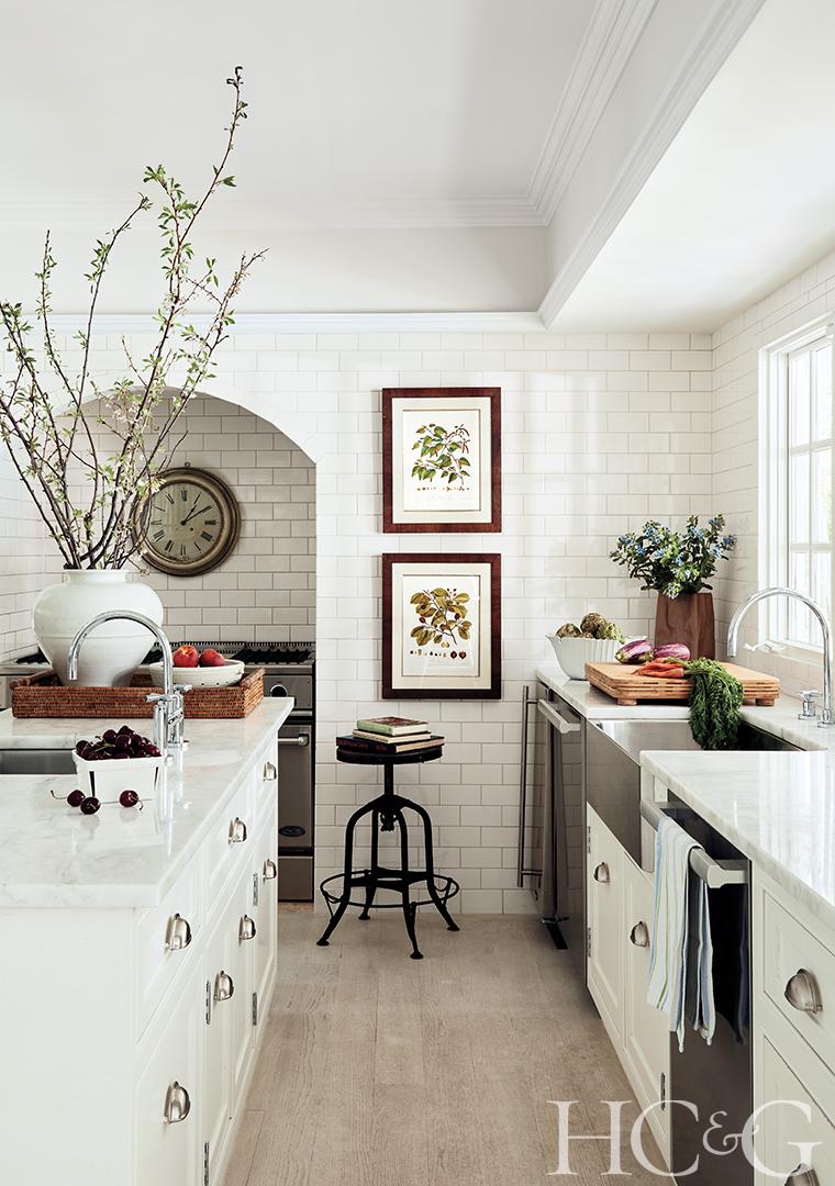 farmhouse style kitchen; white cabinets; subway tile