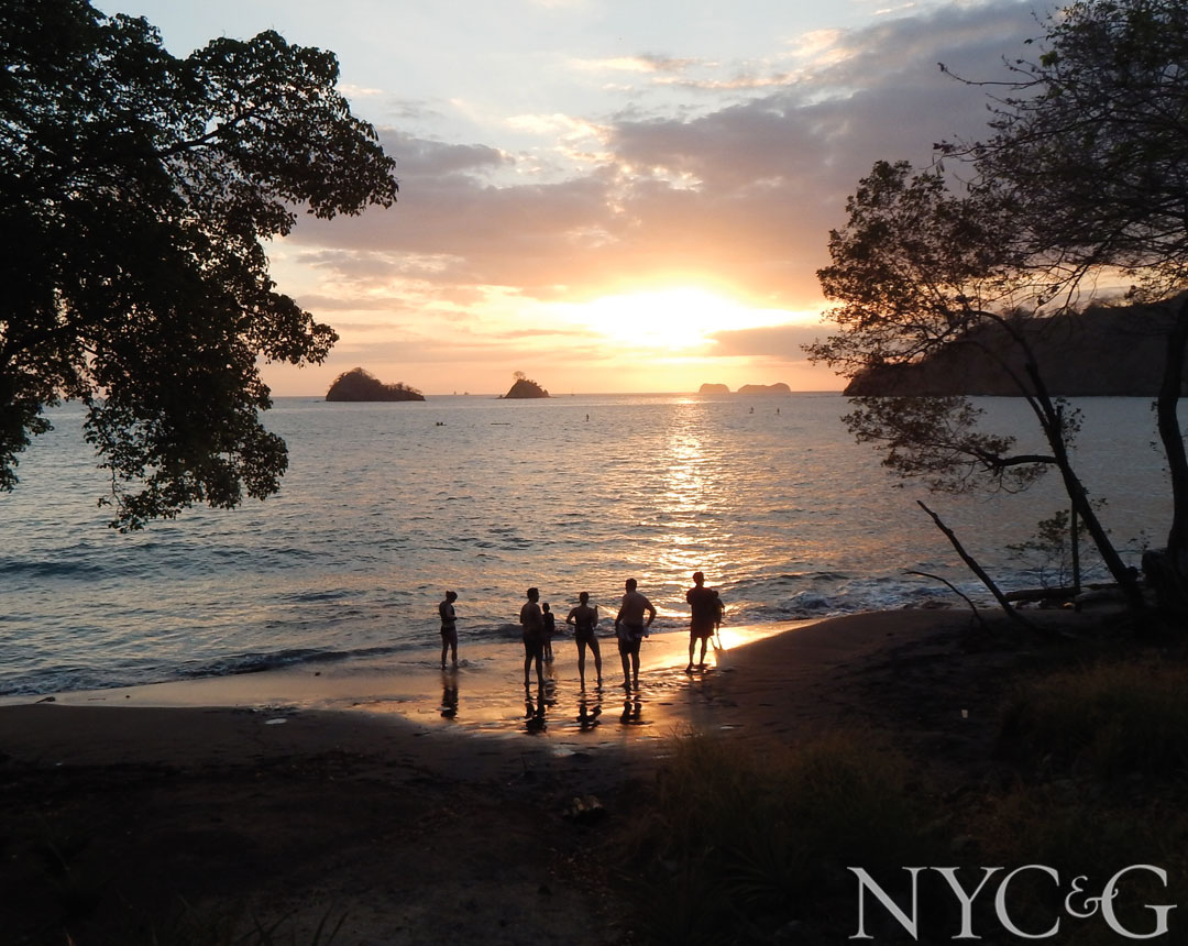 Paddle-boarders take in a stunning sunset off Playa Danta.