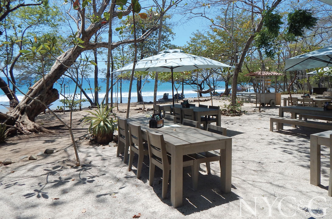 Dining tables at Limonada restaurant overlook Playa Danta, where monkeys frequently visit.