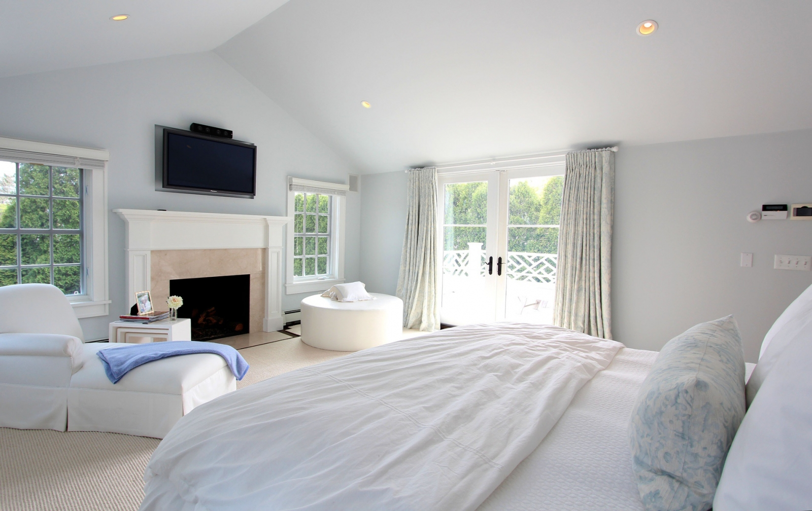 The elegant master bedroom boasts a private balcony.