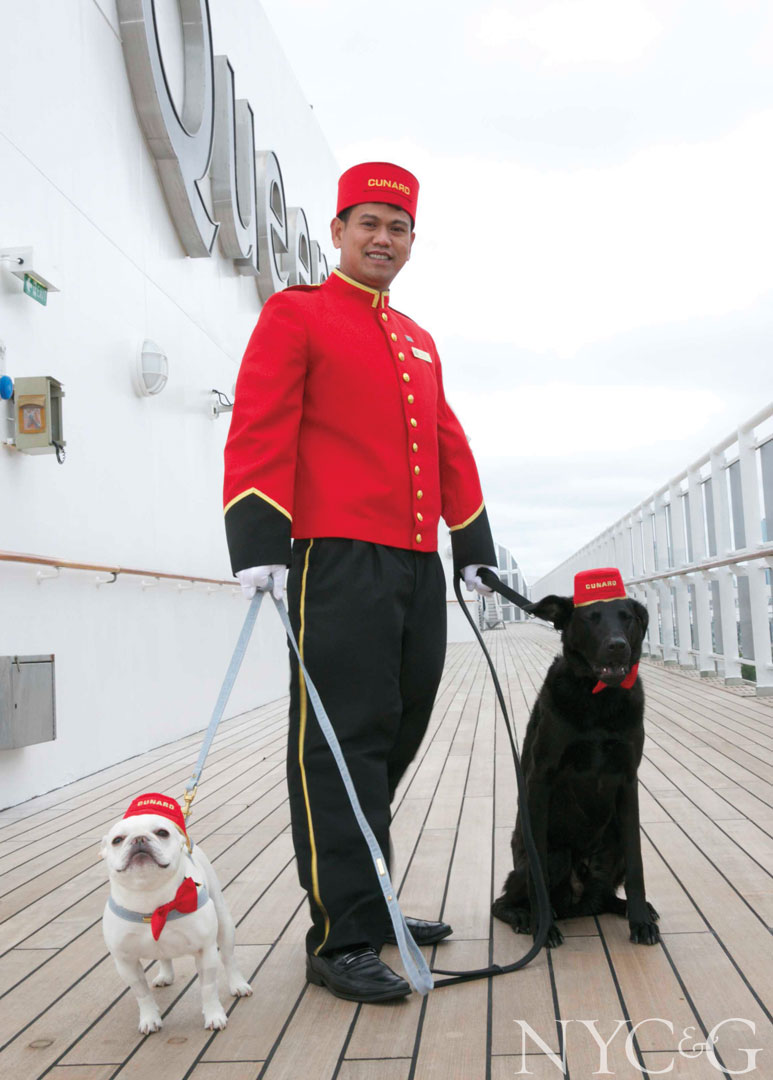 The QM2's kennel master takes two four-legged passengers on deck to catch some air.