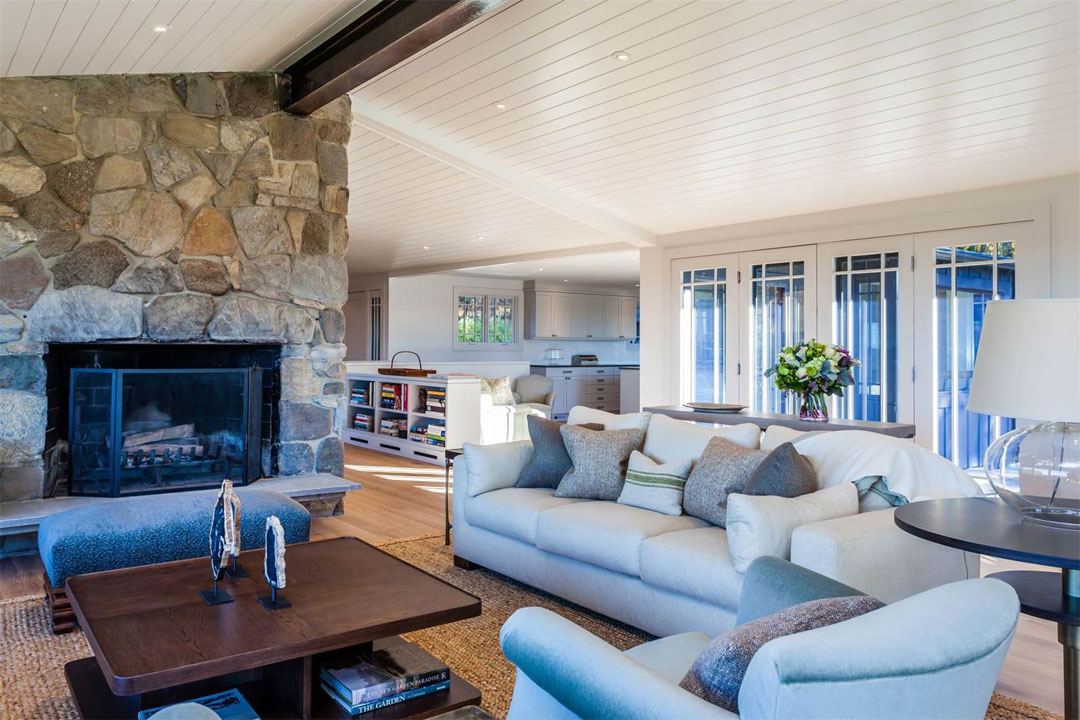 A stone fireplace anchors the family room.