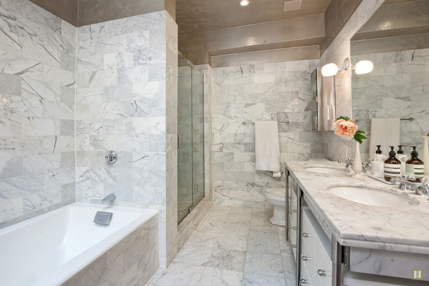 The master bathroom walls are wrapped in marble.