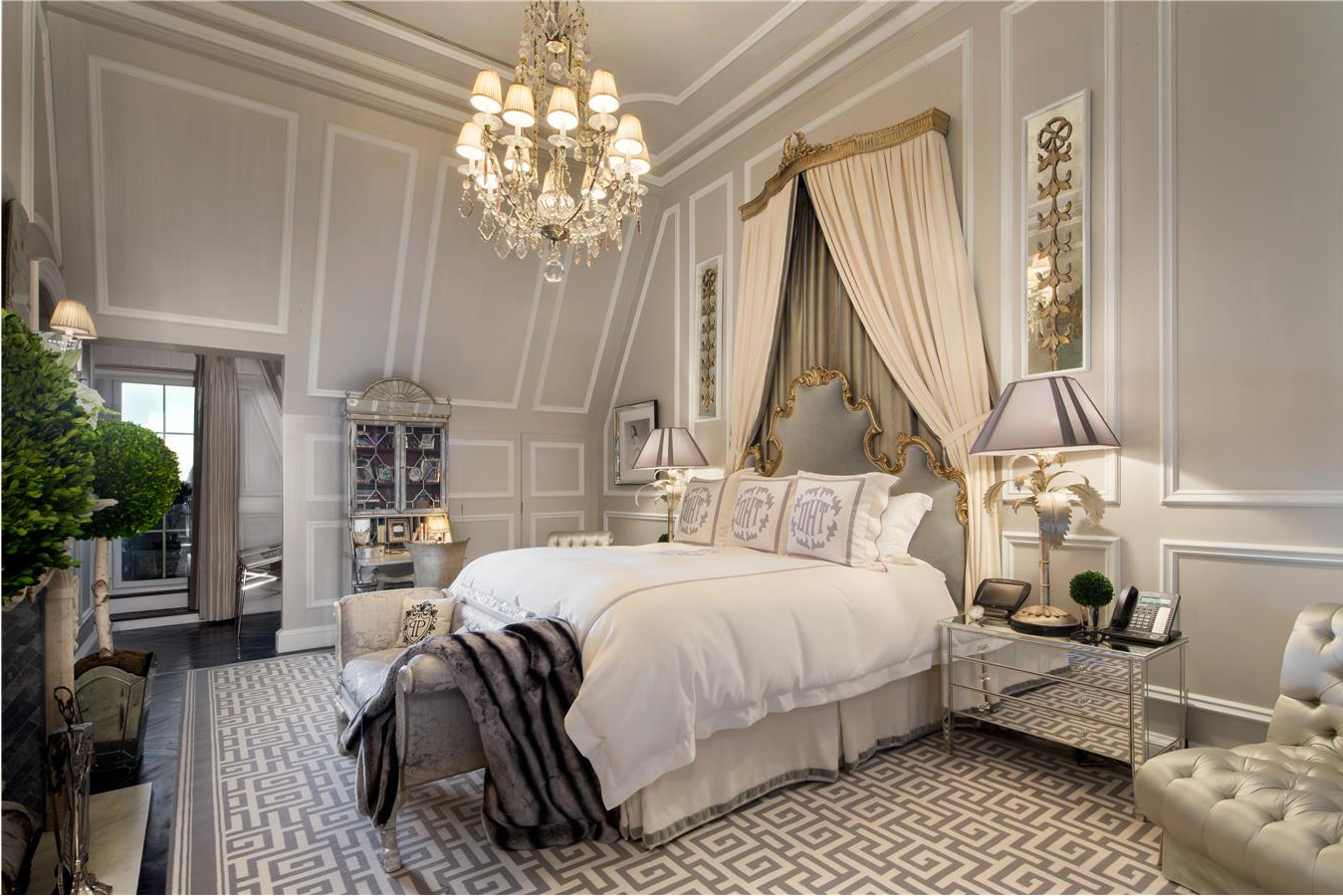 The master bedroom is elegantly appointed and features a fireplace.