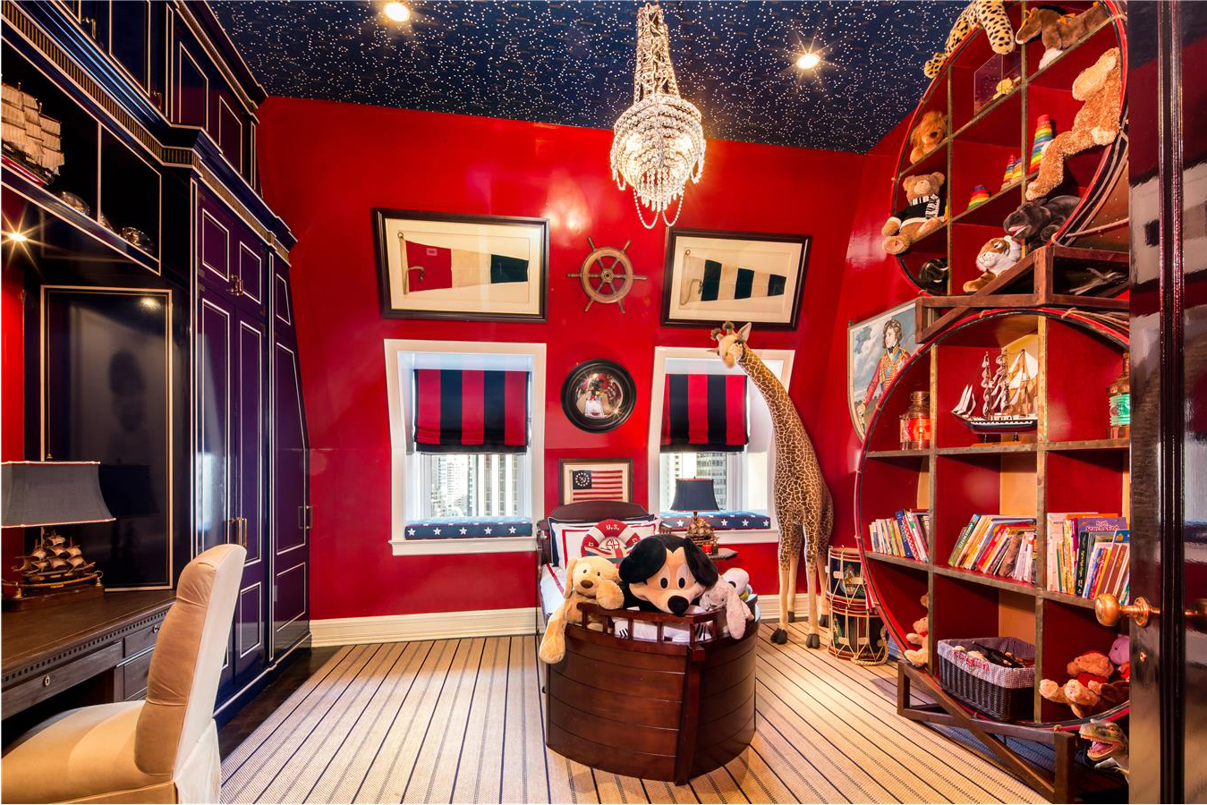 A child's bedroom is decorated with nautical-themed décor.