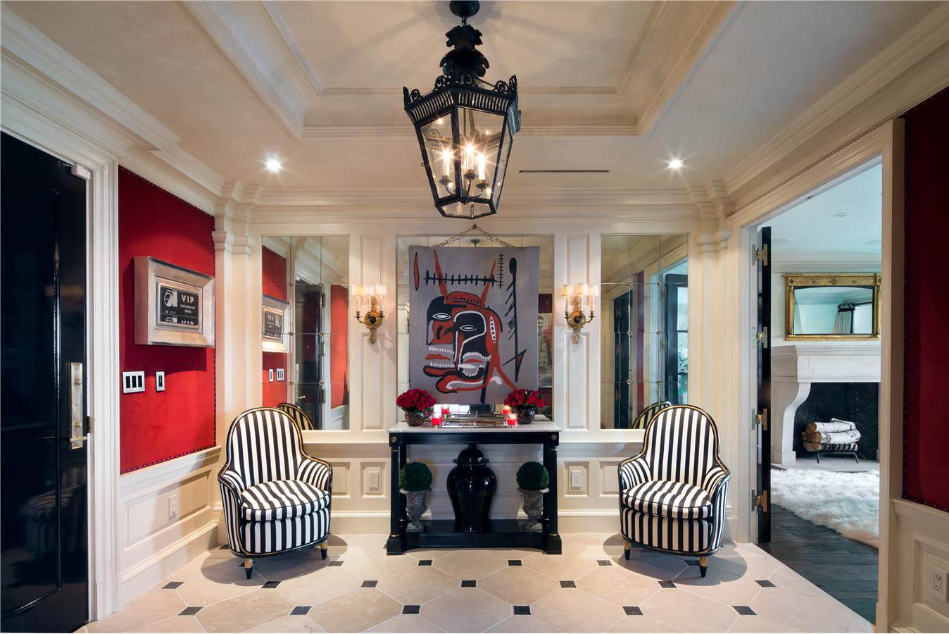 Black-and-white striped chairs greet guests in the entry hall.