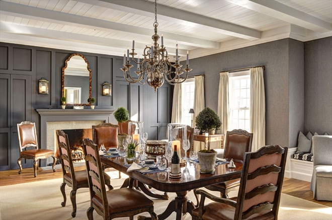 The formal dining room features another fireplace.