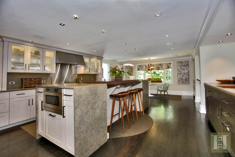 The kitchen features a marble island and state-of-the-art appliances.