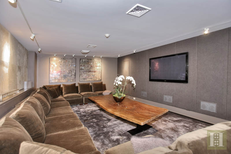 The media room features cowhide acoustic panels.