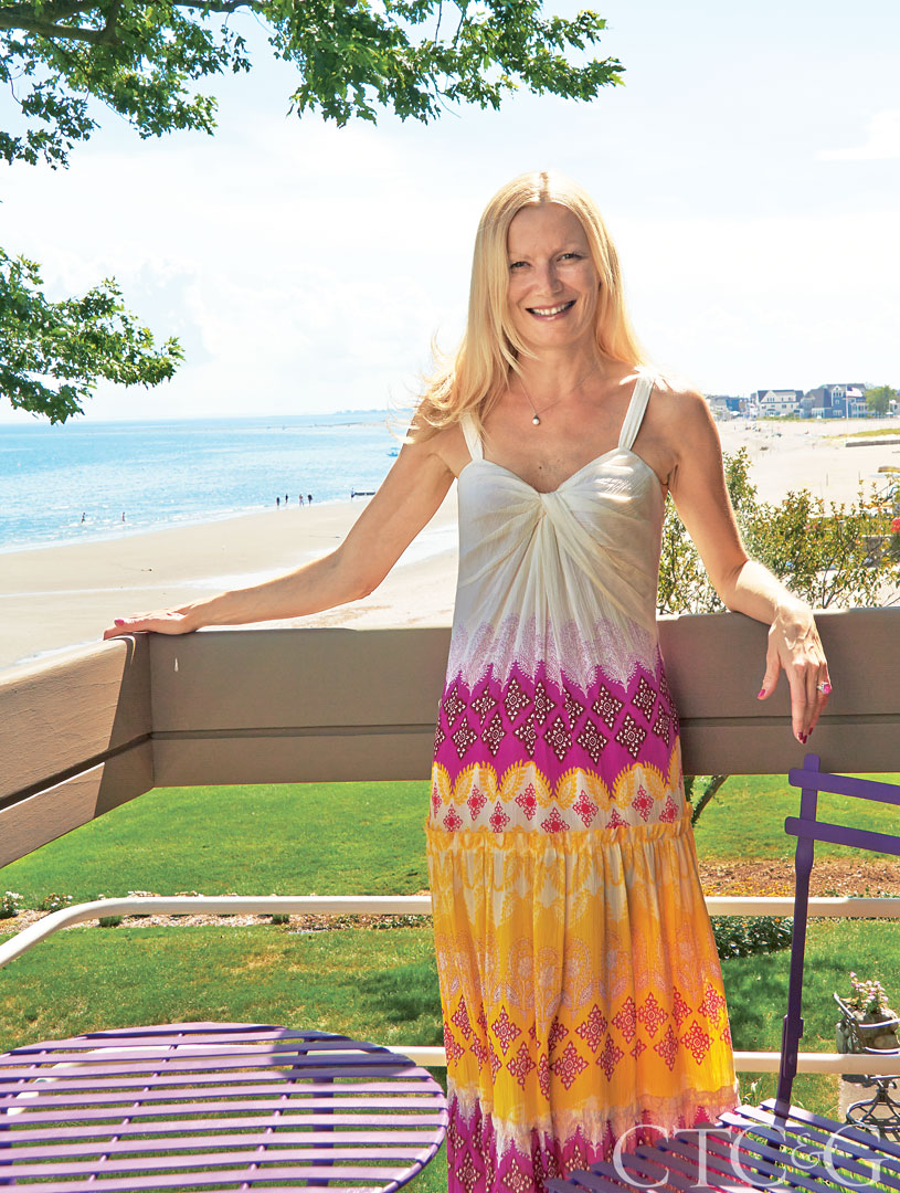 Interior designer Caroline Beaupère on the balcony of her Milford, CT pied-à-terre.