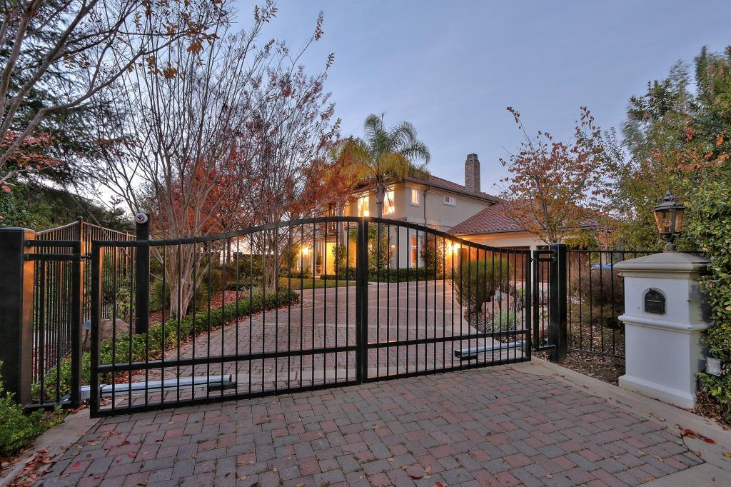The house sits at the end of a gated driveway.