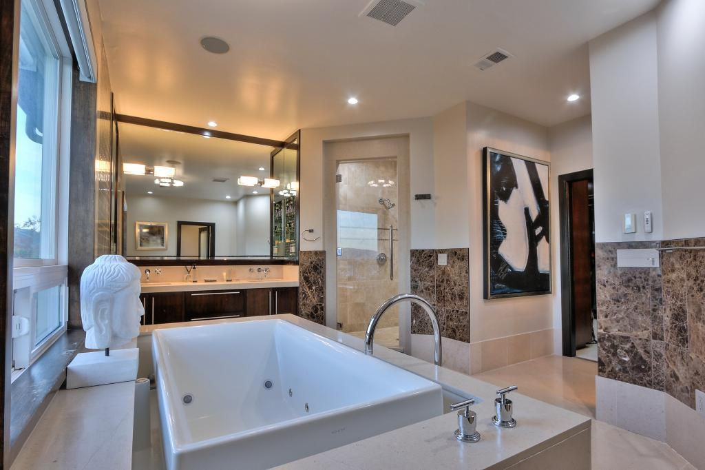 The master bathroom features a soaking tub and shower.