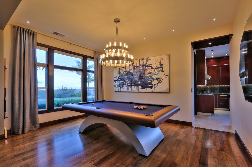 A game room is open to the living room.
