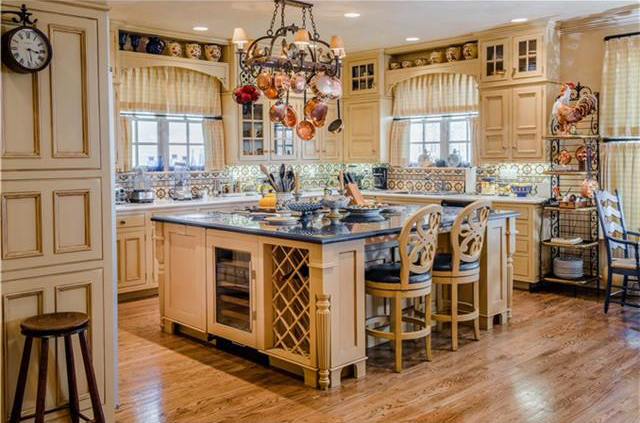 The open kitchen features a large granite island.