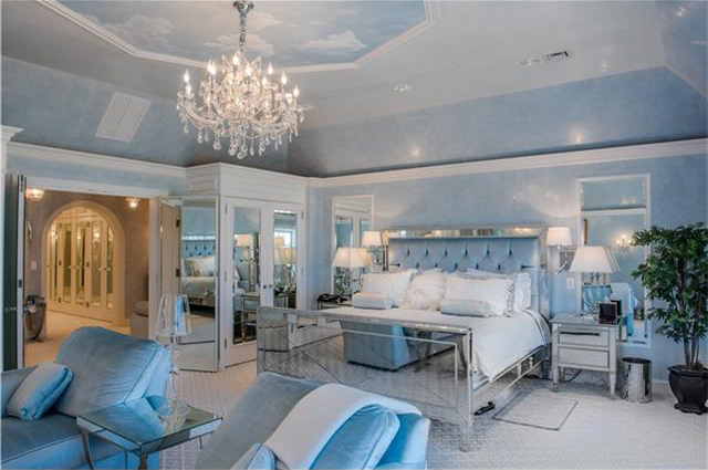 The large master suite has a large mirrored dressing area.