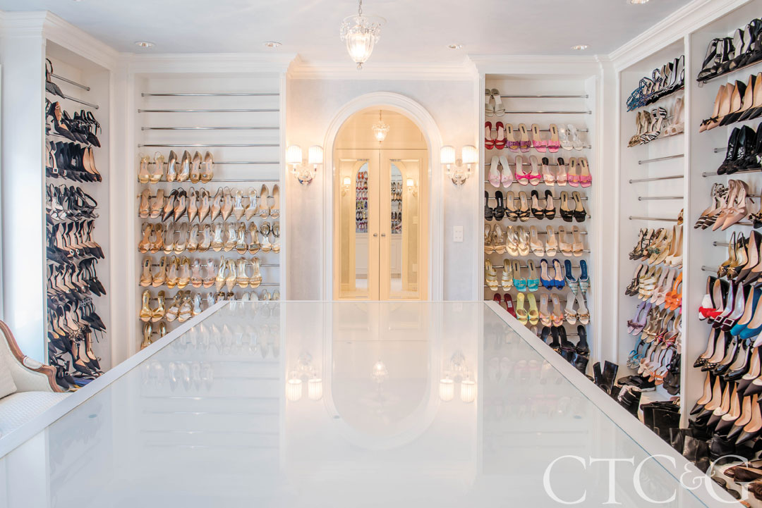 The master suite of this $2.85M Weston listing has a Bergdorfs-worthy master closet.