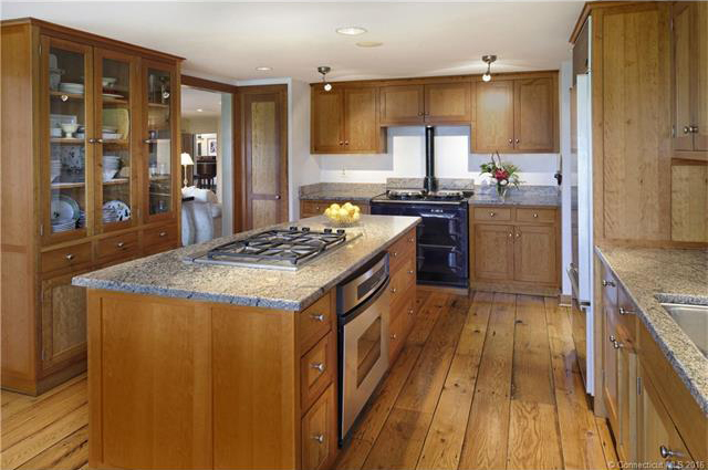 The chef's kitchen features custom cherry cabinets.