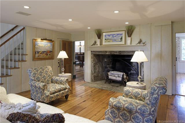 A stone fireplace anchors the living room.
